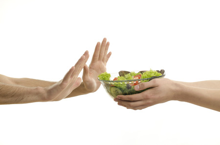 denying: Hand offering a bowl of organic salad and other hands denying isolated on white