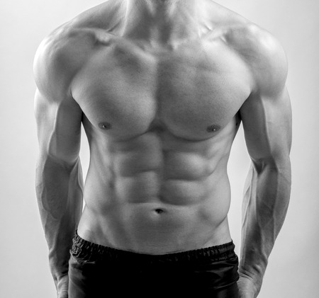 naked male body: Close up on perfect abs. Strong bodybuilder with six pack