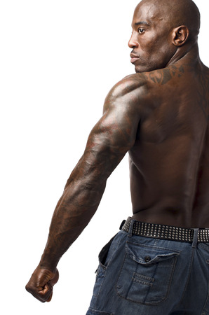 triceps: Black bodybuilder showing his triceps. Profile of a strong man with perfect shoulders, triceps, back Stock Photo