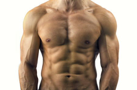 nude body: Close up on perfect abs. Strong bodybuilder with six pack