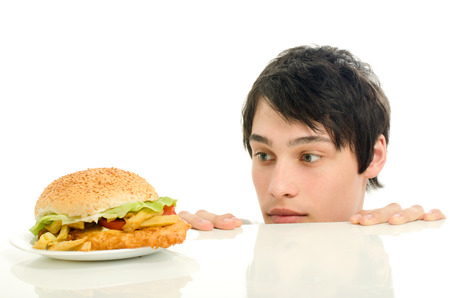 wanting: Man wanting for a big hamburger, fast food, take out for him Stock Photo