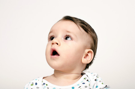 Baby looking up, infant waiting for parents, toddler listening his parents