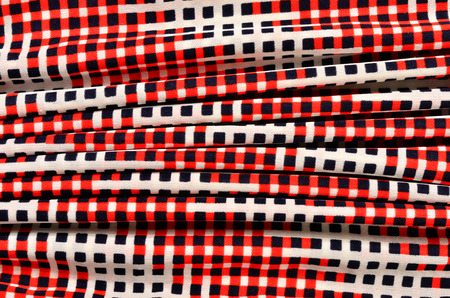 Red, white and blue checked print as background. Stock Photo