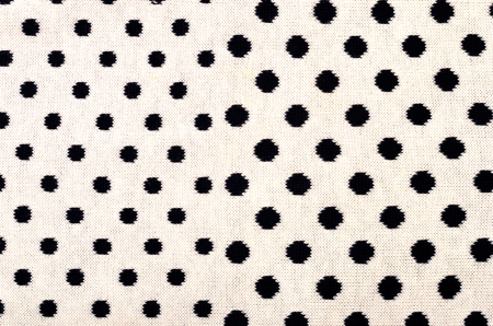 Closeup on white wool with black dots wool texture. 写真素材