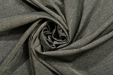 Crumpled grey and silver sparkly textured fabric. 写真素材