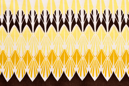 Graphic rhomb abstract print as background.