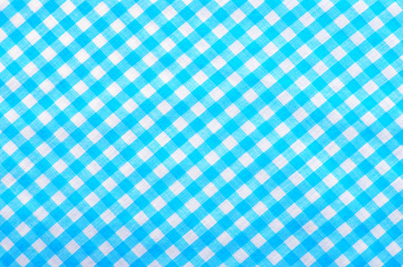 Checked print as background. Little squares pattern on fabric. Stock Photo