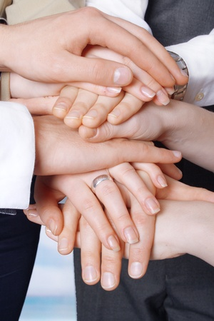 Hands of business people on top of each other  Symbolic picture