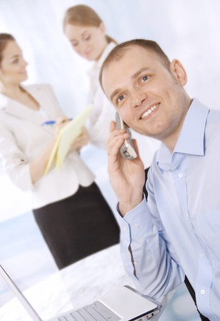 Closeup of a smiling young business executive in a meeting with colleagues  photo