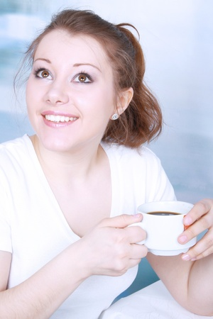 Portrait of smiling beautiful young asian woman drinking coffee Stock Photo - 13593867