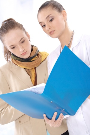 Female medical doctor and her patient discuss the results of tests Stock Photo - 13636316