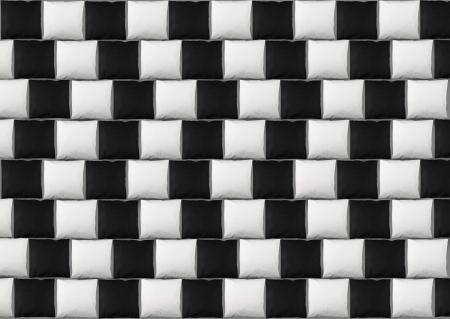 Illusion d'optique: lignes parallèles faites à partir des oreillers en noir et blanc Banque d'images