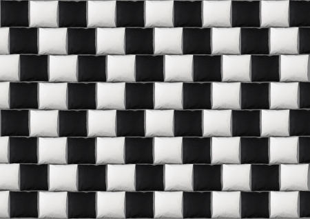 Optical illusion: parallel lines made from black and white pillows photo