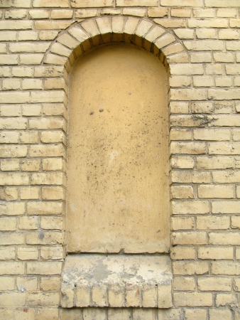 Old, ragged brick wall texture with immured window (for background) photo