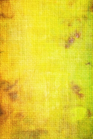 Old canvas: Abstract textured background with green and brown patterns on yellow backdrop. For art texture, grunge design, and vintage paper  border frame photo