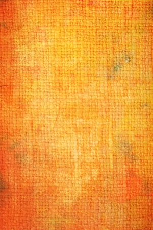Old canvas: Abstract textured background with red and orange patterns on yellow backdrop. For art texture, grunge design, and vintage paper  border frame photo
