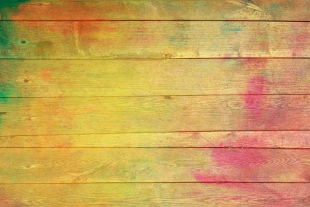 Old wooden painted wall: Abstract textured background with red, yellow, and green patterns. For art texture, grunge design, and vintage paper  border frame photo