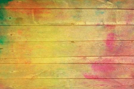 Stare drewniane malowane ściany: Streszczenie teksturowanej tle z czerwonym, żółtym, zielonym i wzorce. Na fakturze Wzornictwo, grunge i rocznika papieru  border frame photo