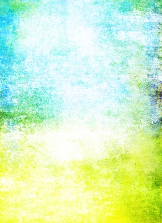 Abstract textured background: blue, yellow, and green patterns on white backdrop. For art texture, grunge design, and vintage paper / border frame Stock Photo - 16852721
