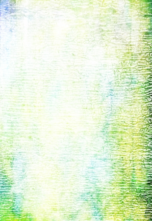 Abstract textured background: blue, yellow, and green patterns on white backdrop. For art texture, grunge design, and vintage paper / border frame Stock Photo - 16852715