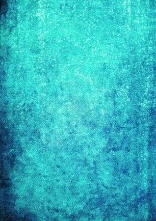 Abstract textured background: dark patterns on blue backdrop. For art texture, grunge design, and vintage paper  border frame photo