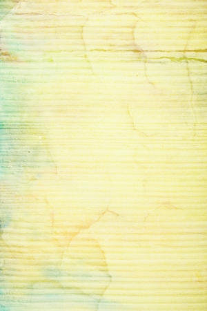 Abstract textured background with blue, green, and brown patterns on yellow backdrop. For art texture, grunge design, and vintage paper  border frame photo