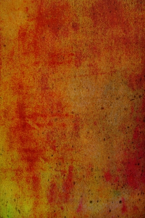 Old canvas: Abstract textured background with red, orange, and brown patterns on yellow backdrop. For art texture, grunge design, and vintage paper  border frame photo