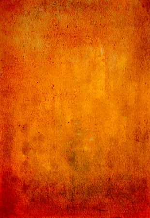 Abstract textured background with red, brown, and yellow patterns on orange backdrop  For art texture, grunge design, and vintage paper   border frame
