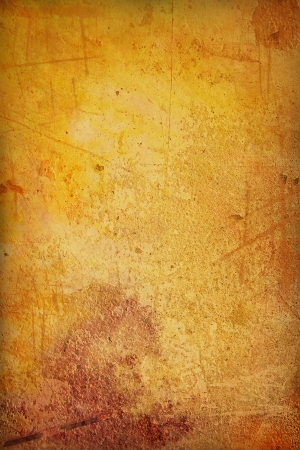 Grain yellow / brown paint wall background or vintage texture. For art texture, grunge design, and old border frame photo