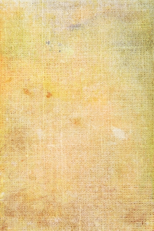 Grain yellow canvas background or vintage paper texture. For art texture, grunge design, and old border frame Stock Photo - 17023742