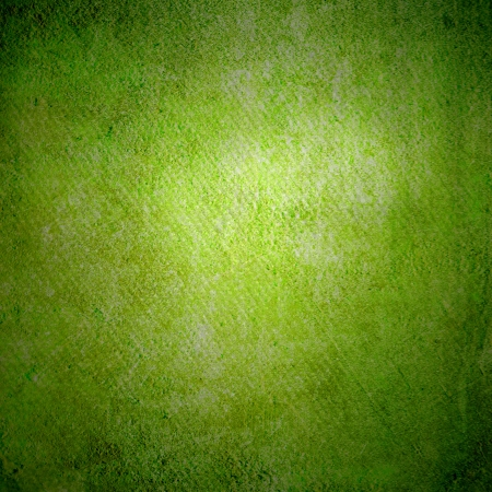 green board: Abstract green background or paper with bright center spotlight and dark border frame with grunge background texture  For vintage layout design of light colorful graphic art