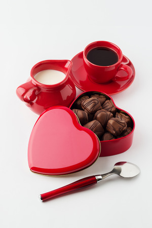 bonbonniere: Coffee with milk, chocolate candy. Isolated on white background.