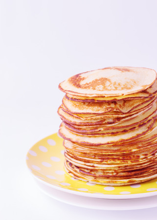 brunch: Stack of pancakes on a plate isolated on white background. Selective focus.