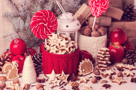 Vintage stile. Christmas decorations - cookies, candys, apples, nuts, spices.