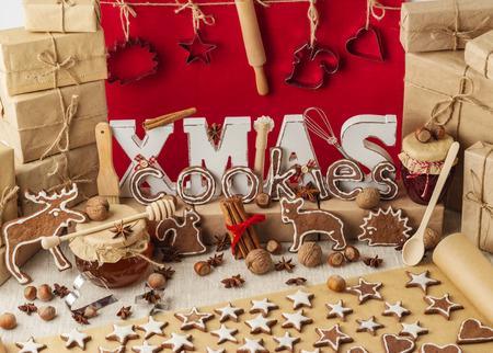 stile: Christmas cookies. Vintage stile. Christmas decorations - letters XMAS, gifts, nuts.