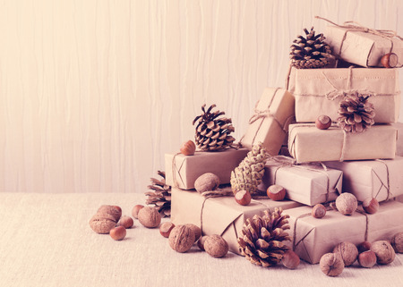 fir cones: Christmas card. Christmas  gifts, nuts and fir cones. Vintage stile.