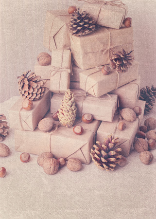 stile: Christmas card. Christmas  gifts, nuts and fir cones. Vintage stile.