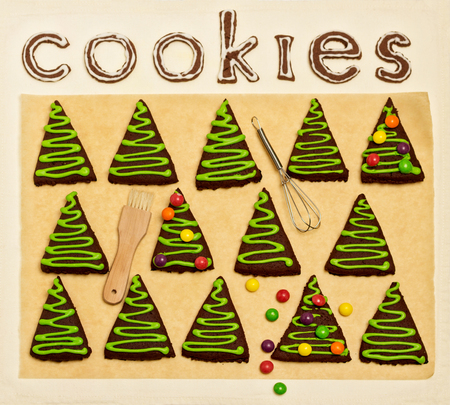 dragee: New Years and Christmas gingerbread trees (ginger and honey cookies) decorated with green glaze and coloured dragee.