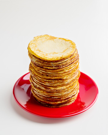 pancake week: Pancake week. Pancakes on a plate isolated on a white background. Selective focus.