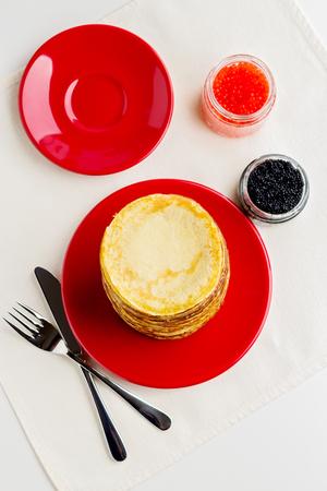 pancake week: Pancake week. Pancakes with red and black caviar. Selective focus.