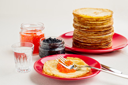 pancake week: Pancake week. Pancakes with red and black caviar. Selective focus.