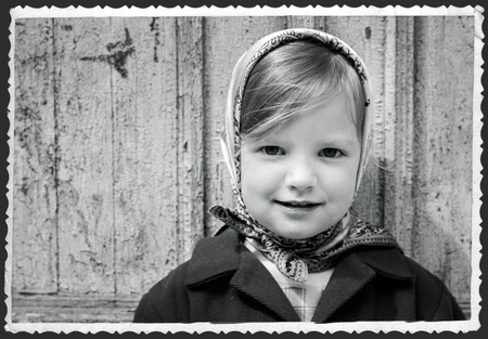kerchief: Photo in retro style. Cute little girl in a kerchief. Selective focus.