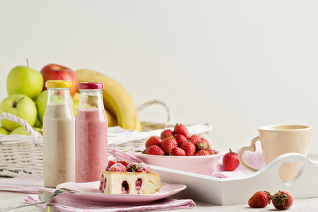 fruits juice: Breakfast. Strawberry cake and coffee, fruit and berries strawberry and banana smoothies. Selective focus.