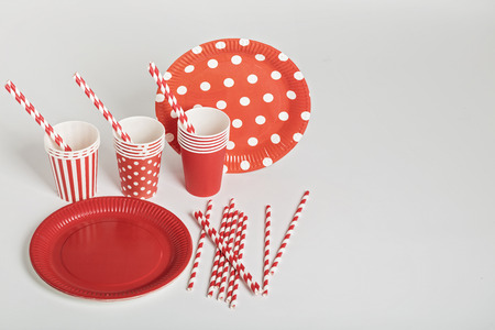 picnic food: Red disposable tableware for parties and picnics. Selective focus.
