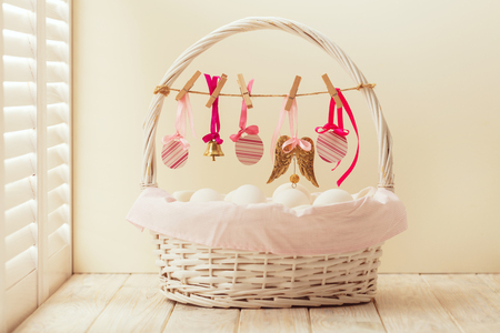 Easter basket with eggs and Easter decor.