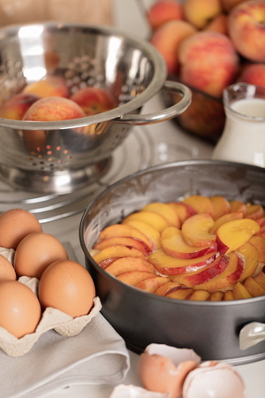 preparation of homemade peach pie kitchen accessories and products selective focus stock photo - Homemade Pie Kitchen
