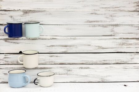 Enameled mugs in retro style on an old wooden Stock fotó