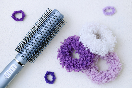 Scrunchy for hair large and small with comb on white rough background