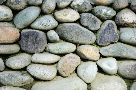 Wall of large round stones. Close-up