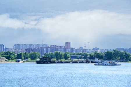 City landscape. Barge and boat on the river. 写真素材